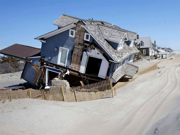 Homes in Mantoloking, Ocean County, severely damaged by Hurricane Sandy. A nonprofit, nonpartisan group put the price tag of Hurricane Sandy at more than $70 billion, with half of the damage sustained in New Jersey.<br />