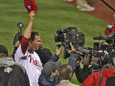 Cameras surround Roy Halladay after pitching the second no-hitter in postseason baseball history. (David M Warren/Staff Photographer)