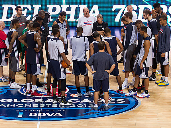 Members of the 76ers gather for an open practice basketball session  in Manchester. (Jon Super/AP)