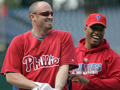 Phillies starter Brett Myers and hitting coach Milt Thompson share a laugh before today´s workout at Citizens Bank Park. (Yong Kim / Staff Photographer)