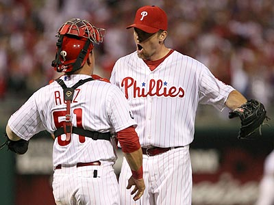 Brad Lidge and Carlos Ruiz celebrate after the final out in the Phillies´ 7-4 win. (Yong Kim/Staff Photographer)