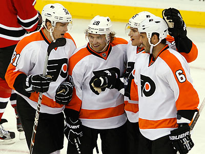 The Flyers have won all of their games so far, despite playing both on the road. (Rick Schultz/AP)