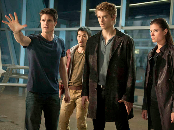 """The Tomorrow People,"" which premieres Wednesday on the CW, stars (from left) Robbie Amell as Stephen, Aaron Woo as Russell, Luke Mitchell as John, and Peyton List as Cara. (Barbara Nitke / The CW)"