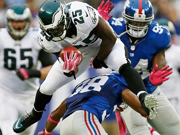 Philadelphia Eagles´ LeSean McCoy (25) leaps over New York Giants´ Trumaine McBride (38) during the first half of an NFL football game Sunday, Oct. 6, 2013, in East Rutherford, N.J. (AP Photo/Kathy Willens)
