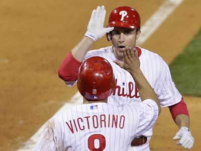 Chase Utley is greeted by Shane Victorino after his two-run homer in the sixth inning of Game 1 of the NLCS. (David Maialetti / Staff Photographer)