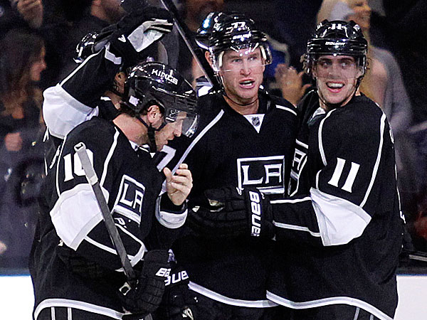 The Kings´ Mike Richards and Anze Kopitar celebrate an overtime goal by Kings center Jeff Carter defeating the Senators. (Alex Gallardo/AP)