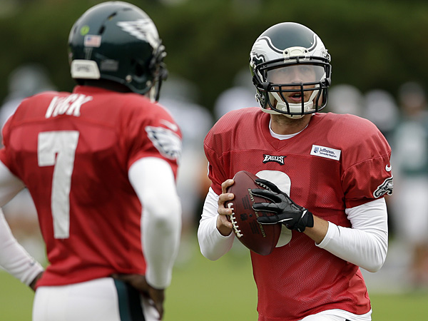 Eagles quarterbacks Michael Vick and Nick Foles. (Matt Rourke/AP)