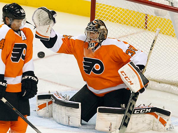 Kimmo Timonen ducks as Flyers goalie Steve Mason makes a save in the third period against the Panthers. (Ron Cortes/Staff Photographer)