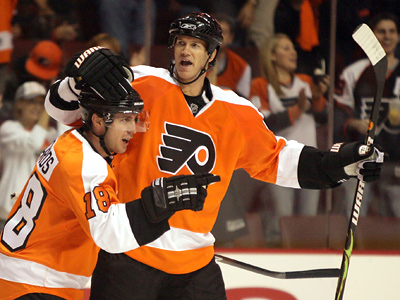 Chris Pronger celebrates with Mike Richards during Tuesday´s win over the Capitals. Pronger will face his former team from Anaheim tonight. (Yong Kim / Staff Photographer)