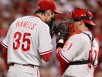 Phillies pitcher Cole Hamels and catcher Carlos Ruiz talk on the mound during Game 3 of the NLDS.  (Michael Bryant/Staff Photographer)