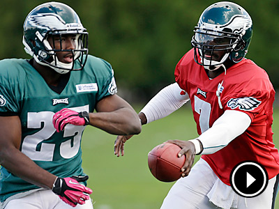 Michael Vick, right, hands off to running back LeSean McCoy during practice. (Matt Rourke/AP)