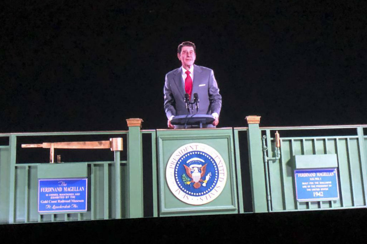 Former President Ronald Reagan appears on a railcar platform making a speech during a whistle stop on the campaign trail, but as a hologram, on display at the Ronald Reagan Presidential Library in Simi Valley, Calif., Wednesday, Oct. 10, 2018. The Reagan Library says it worked with the same Hollywood special effects wizards who helped bring singers Michael Jackson, Maria Callas and Roy Orbison back to life on stage. Officials say the goal is to allow visitors to see Reagan back in the Oval Office, campaigning or at his beloved ranch.