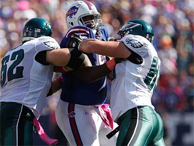 Eagles rookies Jason Kelce (62) and Danny Watkins (63) had a rough time against Marcell Dareus (pictured) and the Bills. (AP Photo / Derek Gee)