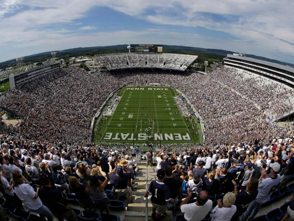 College football fans watch a Penn State game at Beaver Stadium. (Gene J. Puskar/AP file photo)