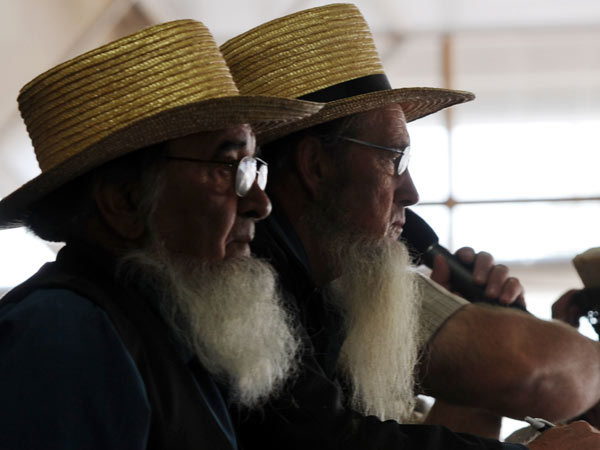 Two members of the Amish community attend Leola Produce Auction in Lancaster County, which hosted the 25th anniversary auction to raise money for the Clinic for Special Children on Saturday, Sept. 20, 2014. (Inquirer/Bradley C Bower)