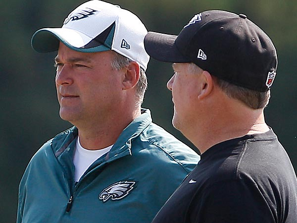 Eagles defensive coordinator Bill Davis and head coach Chip Kelly. (David Maialetti/Staff Photographer)