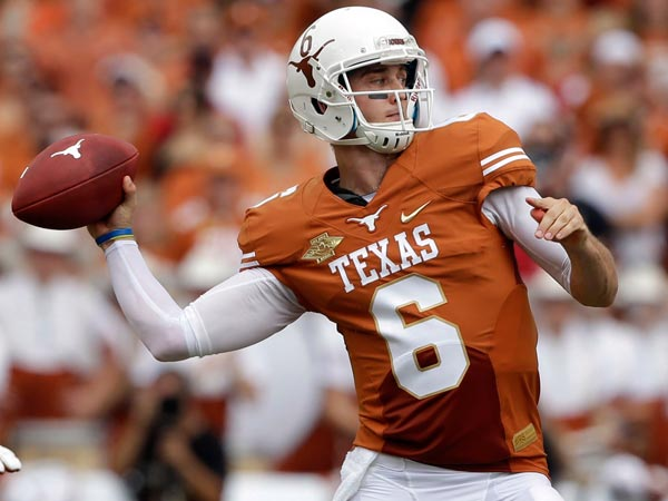 Texas quarterback Case McCoy (6) passes during the first half of an NCAA college football game against the Oklahoma at the Cotton Bowl Saturday, Oct. 12, 2013, in Dallas. Texas guard Mason Walters, left, provideds protection. (LM Otero/AP)