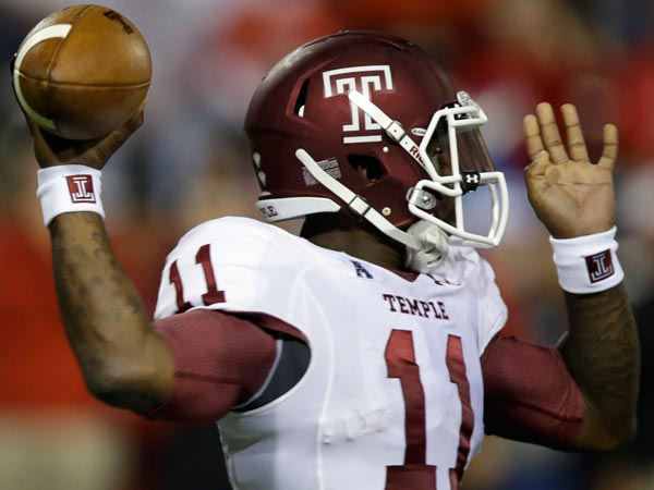 Temple quarterback P.J. Walker passes against Cincinnati in the first half of an NCAA college football game, Friday, Oct. 11, 2013, in Cincinnati. (Al Behrman/AP)