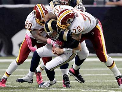 The Redskins´ defense had seven sacks and 10 QB hits against Sam Bradford and the Rams. (Tom Gannam/AP)