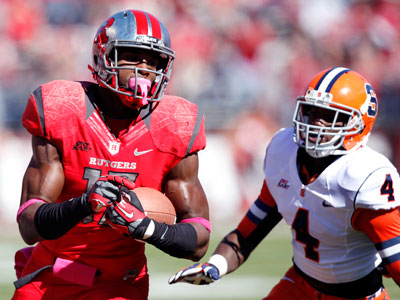 Rutgers wide receiver Brandon Coleman runs past Syracuse cornerback Brandon Reddish. (Mel Evans/AP)