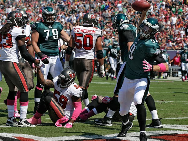 Philadelphia Eagles quarterback Nick Foles (9) spikes the ball after scoring on a four-yard touchdown run against the Tampa Bay Buccaneers during the first quarter of an NFL football game Sunday, Oct. 13, 2013, in Tampa, Fla. (AP Photo/Chris O´Meara)