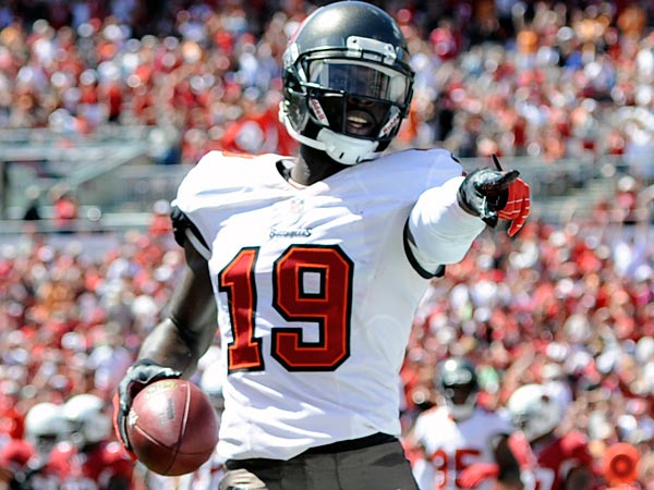 Tampa Bay Buccaneers wide receiver Mike Williams (19) celebrates his first quarter touchdown during an NFL football game against the Arizona Cardinals Sunday, Sept. 29, 2013, in Tampa, Fla. (AP Photo/Brian Blanco)