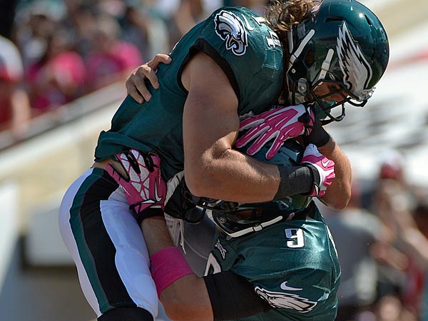 Philadelphia Eagles quarterback Nick Foles (9) celebrates with wide receiver Riley Cooper (14) after Foles scored on a four-yard touchdown run against the Tampa Bay Buccaneers during the first quarter. (AP Photo/Phelan M. Ebenhack)