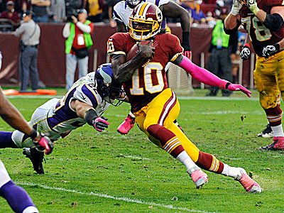 Redskins quarterback Robert Griffin III ran for two touchdowns in a win over the Vikings Sunday. (Richard Lipski/AP)