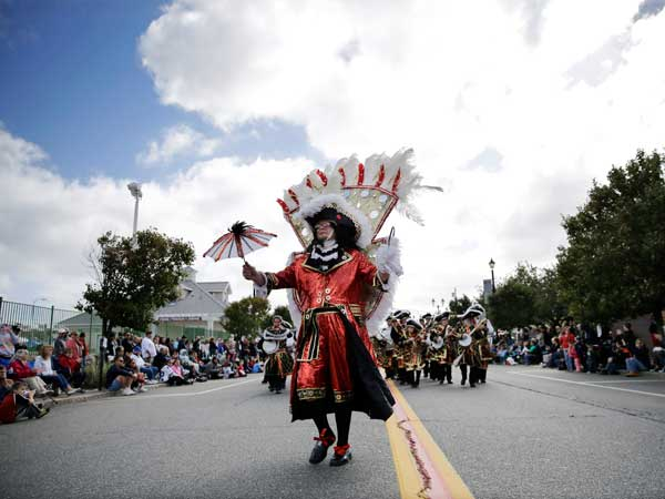 A Mummers group from Philadelphia marches in Seaside Heights, N.J., Sunday, Oct. 13, 2013, during the town´s Italian Street Festival and Columbus Day parade. Pennsylvania and New Jersey are among the 23 states that designate Columbus Day as a paid holiday for state workers. (AP Photo/Mel Evans)