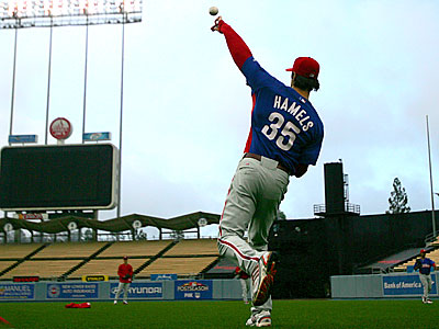 Cole Hamels throws some long toss during practice at Dodgers Stadium.