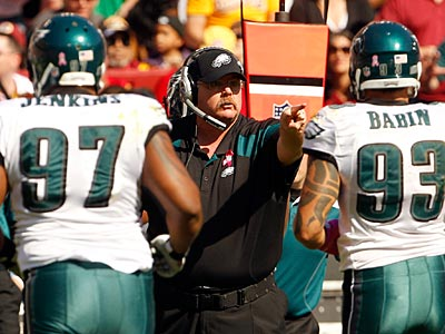 Cullen Jenkins (97) and Jason Babin (93) have combined for 12 sacks this season. (Yong Kim/Staff Photographer)