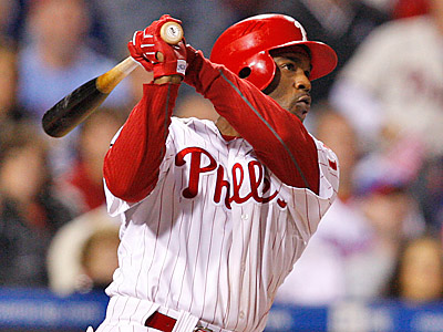 Jimmy Rollins hits a three-run double in the 7th inning. (David Maialetti/Staff Photographer)