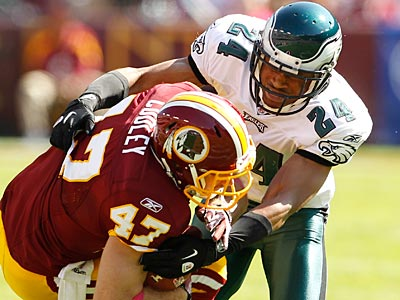 Redskins tight end Chris Cooley exited the game after this hit by Eagles corner Nnamdi Asomugha. (Ron Cortes/Staff Photographer)