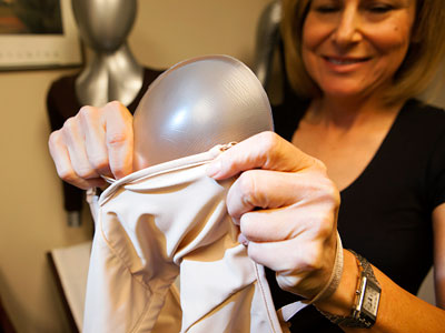 Debra Kimless-Garber inserts a Breast Shaper into one of her mastectomy bras. ED HILLE / Staff Photographer