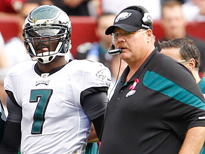 Michael Vick is escorted by coach Andy Reid following a hit in the third quarter of Sunday´s game. (Ron Cortes/Staff Photographer)