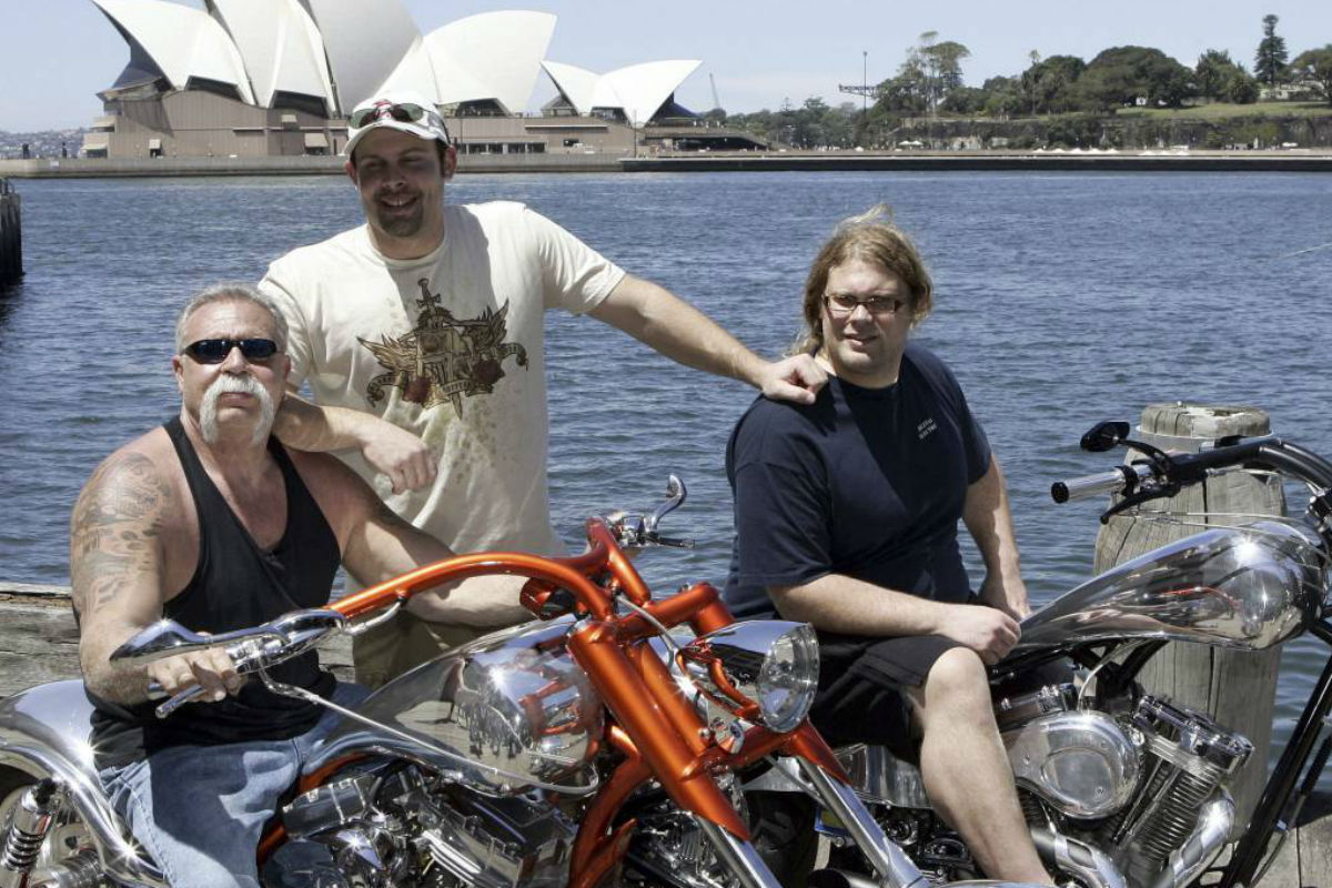 """FILE - In this Feb. 15, 2007, file photo, Paul Teutul Sr. left, and sons Paul Jr. center, and Mikey from the popular reality television show """"American Chopper"""" try out an Australian made chopper during a visit to Sydney, Australia. Discovery Channel announced on Oct. 18, 2017, it will revive the series in 2018."""
