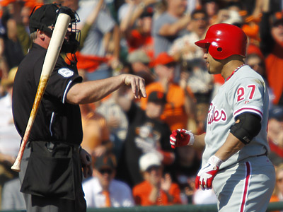 Placido Polanco argues a call strike in the first inning of Game 3 of the NLCS. (Yong Kim / Staff Photographer)