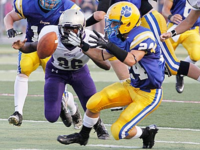Downingtown East´s Andrew Scavicchio (right) recovers a fumble from Roman Catholic. (Michael S. Wirtz/Staff Photographer).