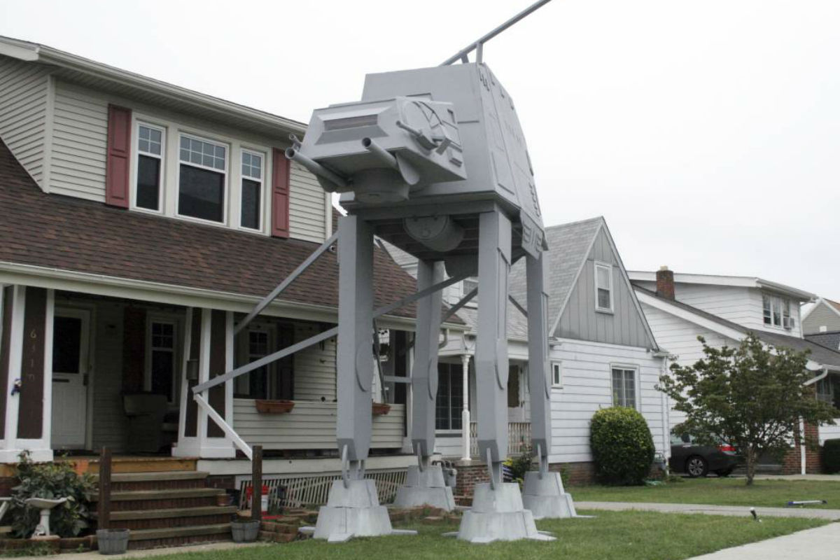 "This Thursday, Oct. 12, 2017 photo shows a replica four-legged All Terrain Armored Transport, or AT-AT walker in Parma, Ohio. Owner Nick Meyer tells Cleveland.com he used wood, hard foam and plastic barrels. He says he enjoys the ""Star Wars"" movies but isn´t a fanatic and simply thought the display would be unique."