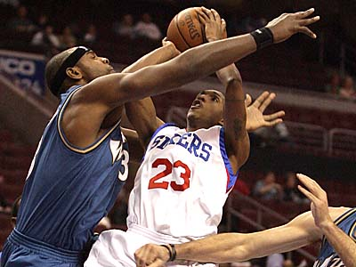 Sixers´ Lou Williams tries to shoot the basketball over Washington Wizards Brendan Haywood (left) and Fabricio Oberto during the first quarter on Tuesday, October 20, 2009.  (Yong Kim / Staff Photographer)