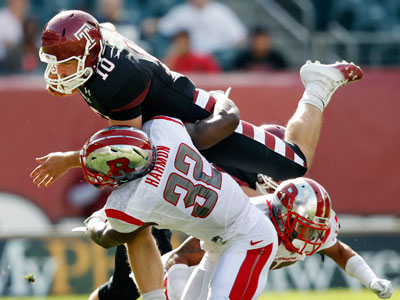 Temple quarterback Chris Coyer is tackled by Rutgers defensive back Duron Harmon during Saturday´s game. (Mel Evans/AP)