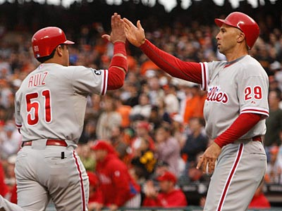 Carlos Ruiz (51) and Raul Ibanez celebrates after scoring on Shane Victorino´s hit in the third inning. (Ron Cortes / Staff Photographer)