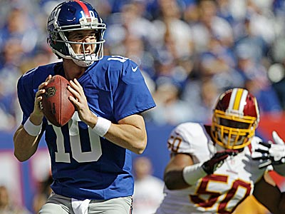 Eli Manning hit Victor Cruz with a 77-yard touchdown to life the Giants past the Redskins. (Kathy Willens/AP)