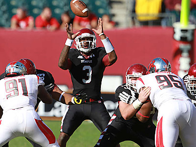 Temple QB Juice Granger gathers a high snap against Rutgers. (David Swanson/Staff Photographer)