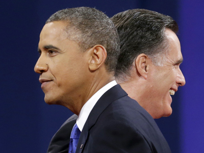 Republican presidential candidate, former Massachusetts Gov. Mitt Romney and President Barack Obama walk past each other on stage at the end of the last debate at Lynn University, Monday, Oct. 22, 2012, in Boca Raton, Fla. (AP Photo / Pablo Martinez Monsivais)