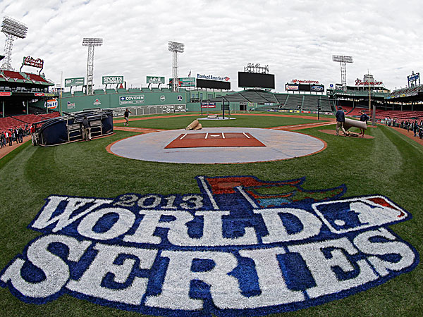 A logo is painted on the field behind home plate at Fenway Park for baseball´s World Series. (David J. Phillip/AP)