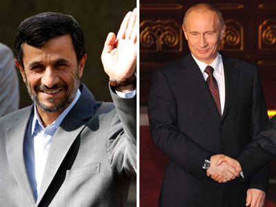 Iranian President Mahmoud Ahmadinejad (left) and Russian Prime Minister Vladimir Putin. (AP Photos)