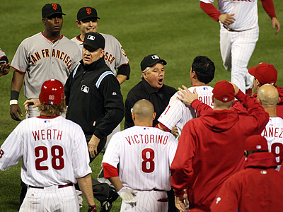 Umpires try to separate the benches after Chase Utley was hit by pitch in the third inning of Game 6 of the NLCS. (David M Warren / Staff Photographer)