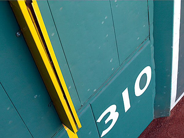 "Baseball scuff marks are seen on the ""Green Monster"" Wall at Fenway Park in Boston. (Elise Amendola/AP)"