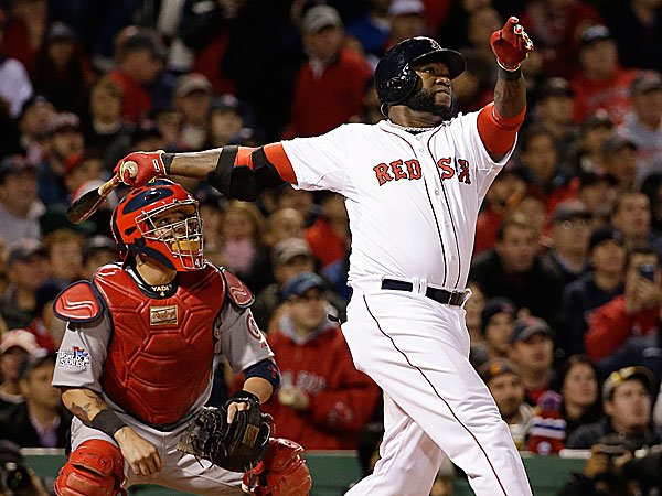 Cardinals catcher Yadier Molina watches as the Red Sox´s David Ortiz hits a two-run home run during the seventh inning. (David J. Phillip/AP)